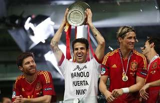Cesc Fabregas lifts the European Championship trophy in 2012