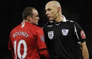 Wayne Rooney confronted Howard Webb after the disallowed goal