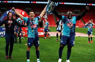 Wycombe's Akinfenwa celebrates promotion to the Championship at Wembley.