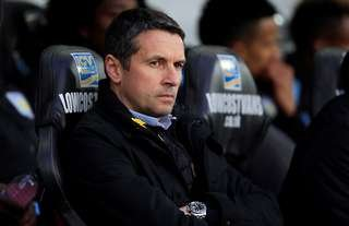 Remi Garde sits on the bench