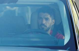 Luis Suarez has left Barcelona's training ground for the last time ahead of a move to Atletico Madrid