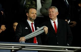 Ed Woodward and Sir Alex Ferguson watch from the stands