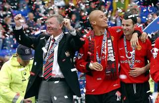 Manchester United's Sir Alex Ferguson, Ryan Giggs and Wes Brown celebrate winning the Premier League title