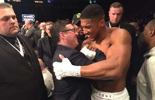 Anthony Joshua celebrates with Professional Fighters League (PFL) CEO Peter Murray