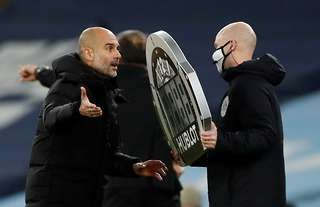 Pep Guardiola and Anthony Taylor