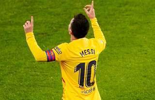 Barcelona's Messi celebrates scoring at Athletic Bilbao.