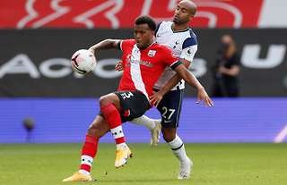 Ryan Bertrand and Lucas Moura fight for the ball