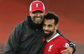 Liverpool boss Klopp with Salah after a Premier League game.