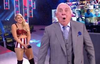 Flair claims to be the daddy of Evans' baby on WWE RAW