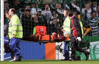 Dida is stretchered off in Celtic vs AC Milan