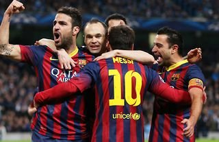 Xavi, Iniesta and Messi in action for Barcelona