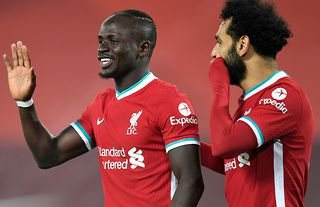 Sadio Mane and Mo Salah in action for Liverpool