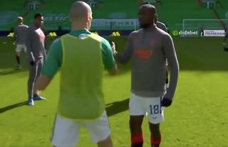 Celtic's Brown shows his support for Rangers' Kamara.