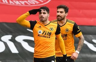 Wolves attacker Pedro Neto with Ruben Neves