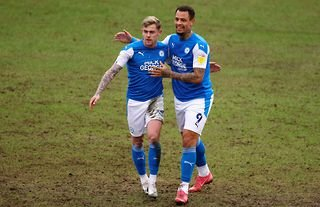 Peterborough forward Jonson Clarke-Harris celebrates with his teammate