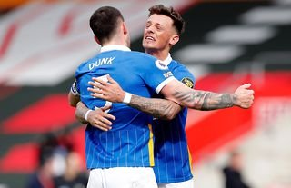 Ben White hugs Lewis Dunk