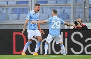 Lazio star Sergej Milinkovic-Savic celebrates with his teammate