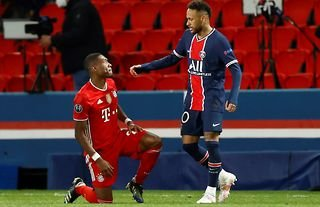 PSG's Neymar consoles Bayern's Alaba in the Champions League.