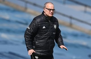 Leeds manager Marcelo Bielsa watching his side