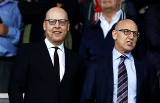 Manchester United co owners Joel Glazer (R) and Avram Glazer in the stands before the match