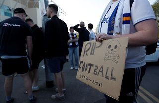People protest the planned European Super League outside the stadium before the match