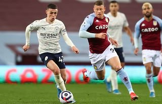 Man City's Foden dribbling at Aston Villa in the Premier League.