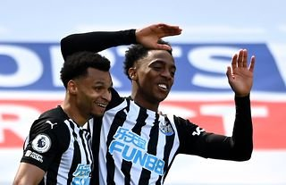 Newcastle midfielder Joe Willock celebrating with Jacob Murphy
