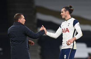 Brendan Rodgers has been linked with Tottenham as he shakes hands with Gareth Bale