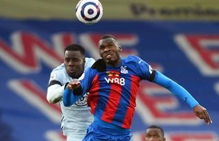 Crystal Palace striker Christian Benteke winning an aerial duel against Kurt Zouma