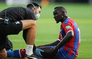 Crystal Palace defender Mamadou Sakho receiving treatment