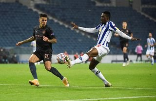 Porto defender and Wolves target Zaidu Sanusi in action against Man City