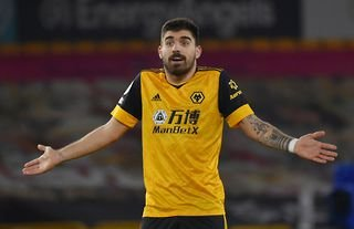 Wolves midfielder Ruben Neves questioning a decision