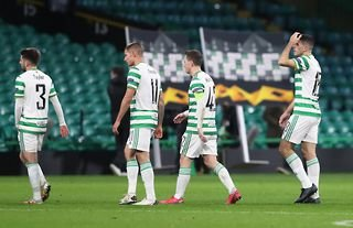 Celtic players look dejected after losing to AC Milan in the Europa League