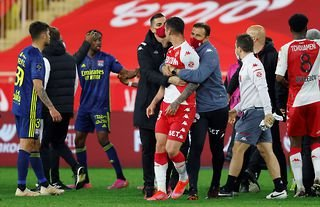 Monaco and Lyon players clash at the final whistle