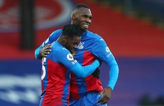 Jeffrey Schlupp and Christian Benteke in action for Crystal Palace