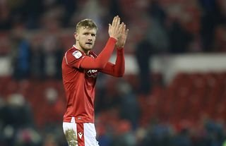 Nottingham Forest defender and West Ham target Joe Worrall claps supporters