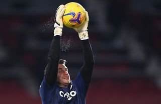 Aston Villa goalkeeper Tom Heaton warms up against Manchester United at Old Trafford
