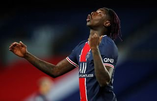 PSG forward Moise Kean, on loan from Everton, looks to the skies