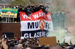 Manchester United fans protest against the Glazer's ownership of the club