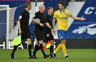 Brighton's Lewis Dunk complaining to match officials after a match against West Brom