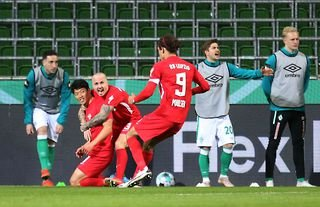 RB Leipzig forward and Crystal Palace target Hwang Hee-chan celebrating a goal