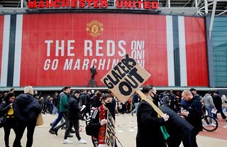 Manchester United fans protest against the Glazer family outside of Old Trafford