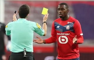 Leicester City target Boubakary Soumare receives a yellow card for Lille
