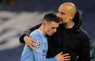 Phil Foden embraced by Pep Guardiola after Manchester City's win against PSG in the Champions League