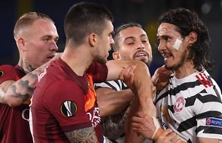 Man Utd's Cavani was involved in a clash with AS Roma players.