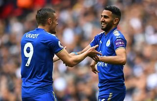Riyad Mahrez celebrates with Jamie Vardy while playing for Leicester City