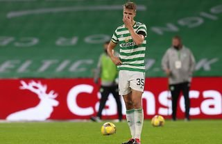 Celtic defender Kristoffer Ajer looks dejected after losing in the Champions League qualifer at Parkhead