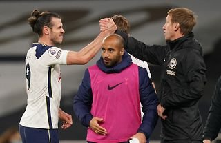 Brighton manager Graham Potter shakes hands with Gareth Bale at the Tottenham Hotspur stadium in November 2020