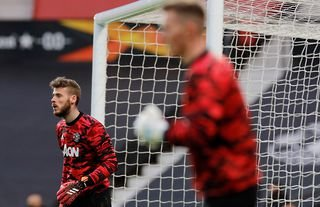 Manchester United goalkeeper David De Gea warms up alongside Dean Henderson at Old Trafford before playing AS Roma