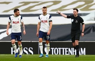 Tottenham Hotspur players Pierre-Emile Hojbjerg and Eric Dier look dejected after losing to Manchester United